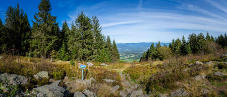 Hiking to the Saustein on Mountain Bröller in the bavarian forests Germany
