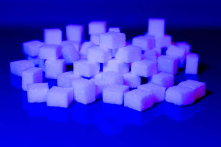 Sugar cubes in different arrangements and colored light. Bavaria Germany, Arrow, Cubes, Pile, Square,