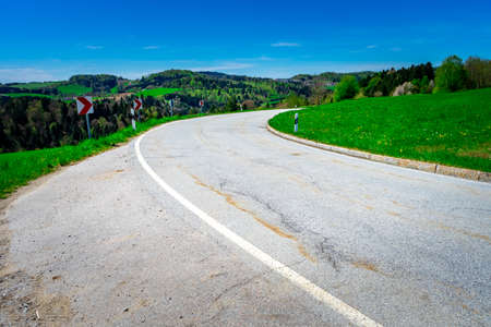 winding road in the bavarian forest near the Ilz valley Germany