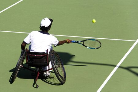 Wheel Chair Tennis for Disabled Persons (Men) Stock Photo