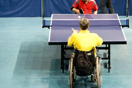 disabled sports: Wheel Chair Table Tennis for Disabled Persons Stock Photo