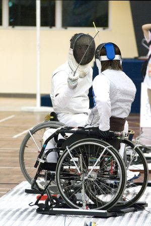 disabled sports: Wheel Chair Fencing for Disabled Persons