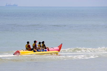 tug boat: Family on Banana Boat