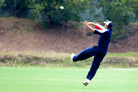 bowl game: Cricket game fielder in action. Stock Photo
