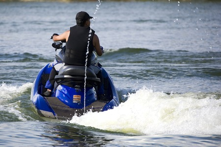 enthusiast: Image of a jet ski enthusiast in action.