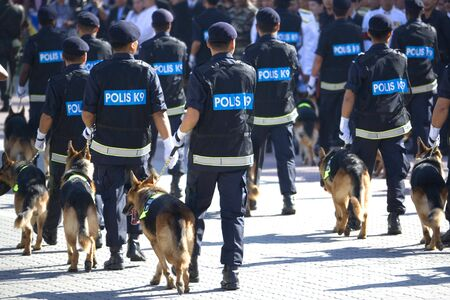 police force: Image of the police canine unit marching at a parade.