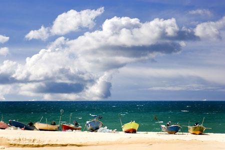 terengganu: Small fishing boats on a tropical beach at Terengganu, Malaysia.