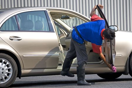 car cleaning: Image of a commercial car washer at work.