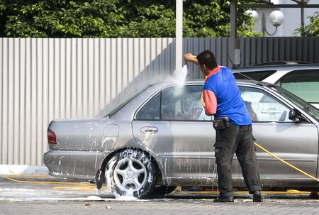maintain: Image of a commercial car washer in action. Stock Photo