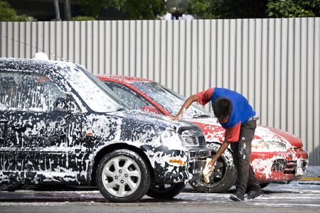 Image of a commercial car washer in action. Stock Photo