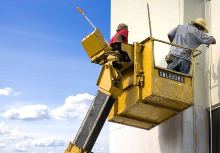 leverage: Image of painters doing what they know best. Stock Photo