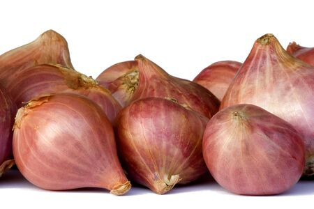 pungent: Isolated macro image of fresh red onions.