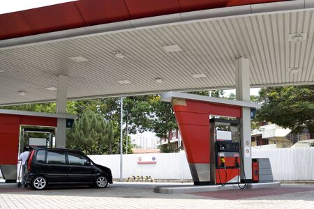 Image of a gas station with a motorcar being refulled. photo