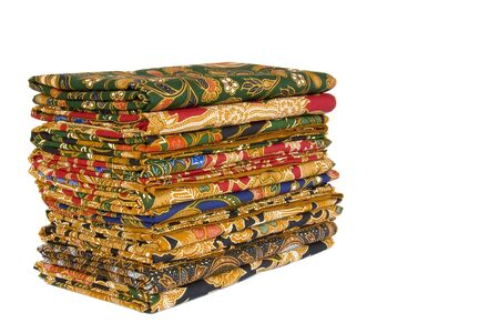 sarong: Isolated image of a stack of Batik Sarongs.