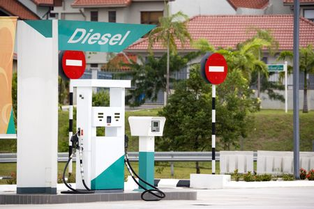 fueling pump: Image of a diesel pump at a gas station.