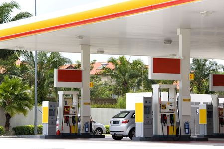 fueling pump: Image of a gas station with cars being refulled. Stock Photo
