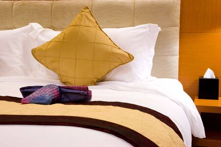 Image of a comfortable looking hotel bed. Stock Photo