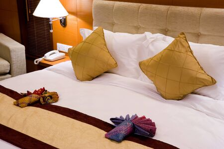 accomodation: Image of a comfortable looking hotel bed. Stock Photo