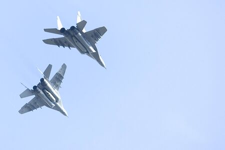 Image of a pair of Royal Malaysian Air Force FA-18 Hornet jet fighters. photo