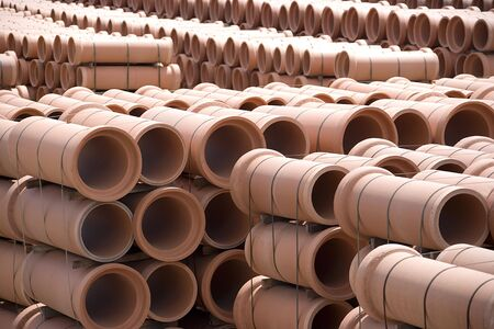 Image of clay pipes at a factory stockyard. Stock Photo