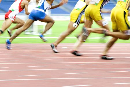 blurring: Image of 100 meters athletes in action with intentional blurring.