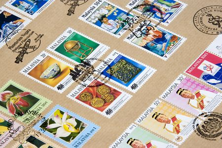 postmarked: Image of postmarked Malaysian commemorative stamps.