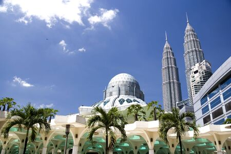prayer tower: A modern designed mosque located at the Kuala Lumpur City Centre, Malaysia.