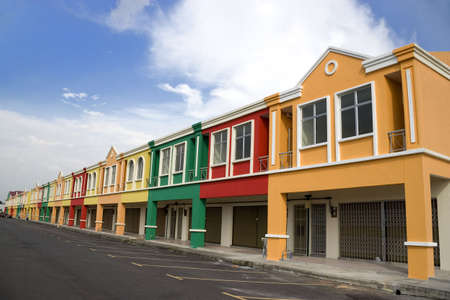 Image of a row of new colouful shop houses. Stock Photo