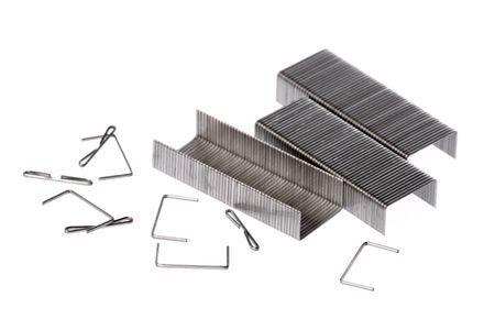 staples: Isolated macro image of metal staples. Stock Photo