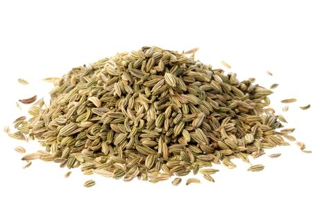 fennel seeds: Isolated macro image of fennel seeds. Stock Photo