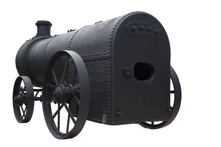steam engines: Isolated image of an antique steam engine. This steam engine was recovered from the jungles of Malaysia and was reputed to be one of the first steam engines to be brought into Malaysia by the British from England to cater for a Malayan tin mine.  Stock Photo