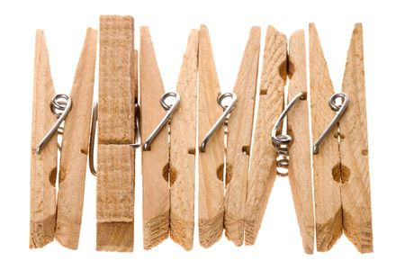 Isolated macro image of wooden laundry pegs. Stock Photo - 3592149