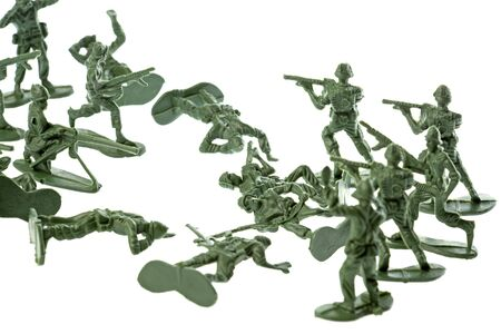 green plastic soldiers: Isolated image of toy soldiers. Stock Photo
