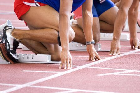 meters: Image of a 100 meters athlete warming-up at the starting block. Stock Photo