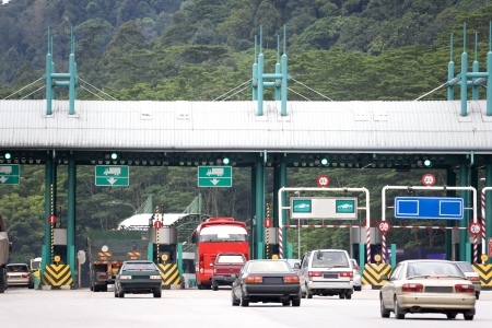 toll: Highway toll collection booths in Malaysia. Stock Photo