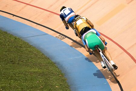 Image of participants in a cycling points race held at a velodrome. Stock Photo