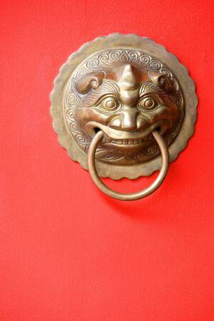 Image of an antique door knob on a bright red door. Stock Photo - 3668744