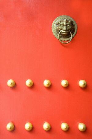 Image of an antique door knob on a bright red door. Stock Photo - 3668739