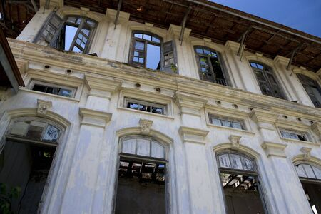 subsequently: Image of a dilapidated heritage building located at UNESCOs World Heritage site of Georgetown, Penang, Malaysia. It used to be a proud home for one of Georgetowns richest man, subsequently a Chinese school and now unfortunately left to decay.