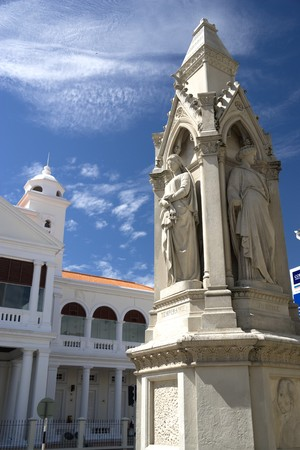 justices: Statues of Justice and the old courthouse building located at UNESCOs World Heritage site of Georgetown, Penang, Malaysia.