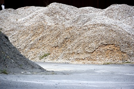 meant: Image of a granite stone aggregate meant for road construction at a rock quarry in Malaysia. Stock Photo