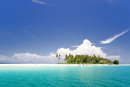 fishing hut: Image of a remote Malaysian tropical island with deep blue skies, crystal clear waters and coconut trees. Stock Photo