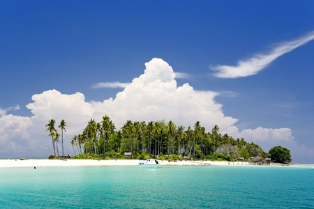 pacific islands: Image of a remote Malaysian tropical island with deep blue skies and crystal clear waters.