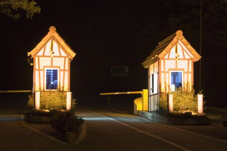 twin house: Image of guard houses at night.