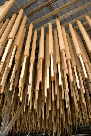 Image of joss sticks being hang dried at a factory in Malaysia. photo