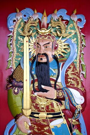 bass relief: Image of a deity on a Chinese temple door.