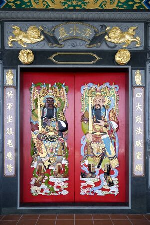 deities: Image of Chinese temple doors with very colourful guardian deities.