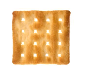 Isolated image of a cream cracker biscuit.