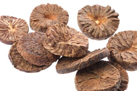 Isolated macro image of betel nut slices.