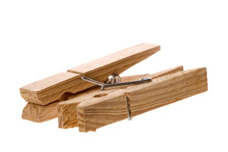 Isolated macro image of wooden laundry pegs. Stock Photo - 4126747